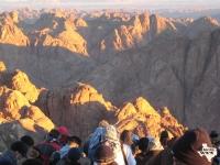 folks walking down Sinai at sunrise
